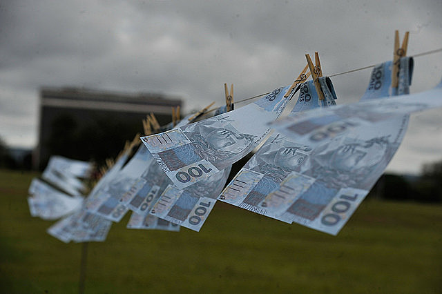 Brazilian real bills hung in protest against corruption and money laundering in Brasília
