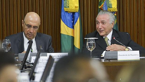 Henrique Meirelles e Michel Temer durante anúncio de novas medidas econômicas