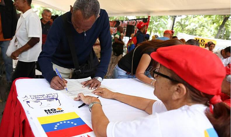 """Governo da Venezuela espera recolher 13 milhões de assinaturas com a campanha """"No + Trump"""""""