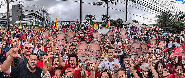 Over 10,000 people protested Sunday outside the Federal Police headquarters where Lula has been held for the last year