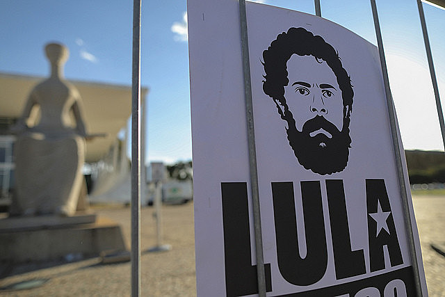 A sign with a drawing of ex-president Lula during a protest calling for his freedom in Brazil's capital city, Brasília