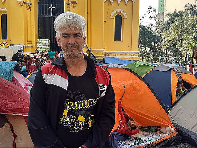 A survivor of the fire, Adilson da Silva is camping outside a church with his family and fears authorities might forget about them